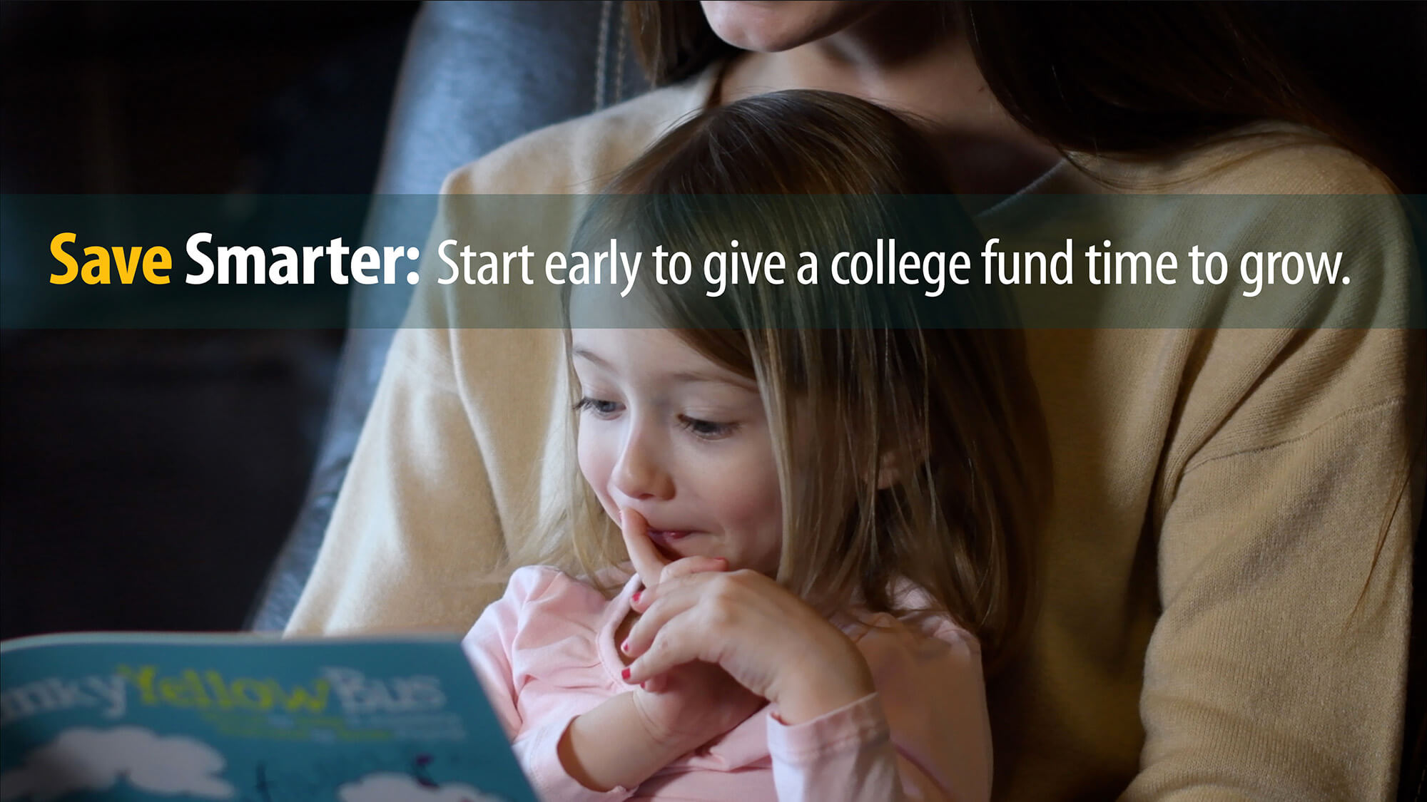 Mom reads book to young girl. Like her financial savings, she is planning ahead for college.